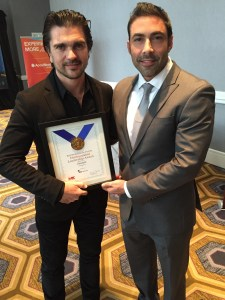 "Jesus Salas Presents Award to ""Juanes"""