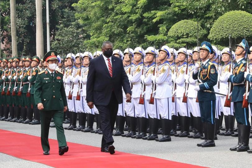 U.S. Secretary of Defense Lloyd Austin with Vietnamese Defense Minister Phan Van Giang, left, inspects an honor guard in Hanoi, Vietnam, Thursday, July 29, 2021. Austin is seeking to bolster ties with Vietnam, one of the Southeast Asian nations embroiled in a territorial rift with China, during a two-day visit. (Nguyen Trong Duc/VNA via AP) The Associated Press