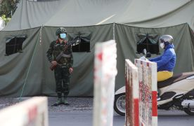 A military checkpoint is seen during lockdown amid the coronavirus disease (COVID-19) pandemic in Ho Chi Minh, Vietnam August 23, 2021. REUTERS/Stringer