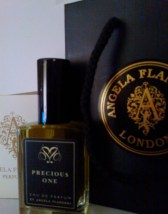 I bought Precious One, the FiFi award-winning soft vetivert perfume.