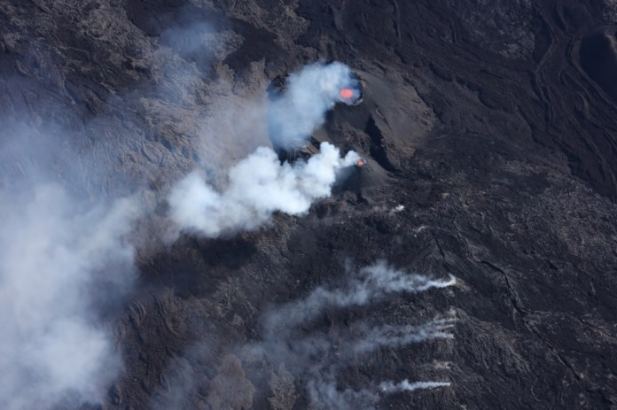 Aerial view of two main ash cones at the current eruption site of the volcano (Image: OVPF)