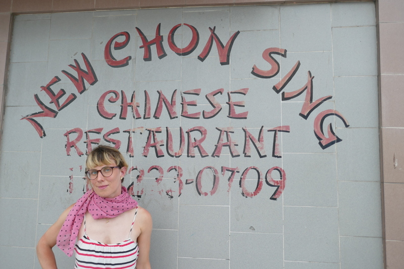 Anete in front of a Chinese restaurant in Belize City.