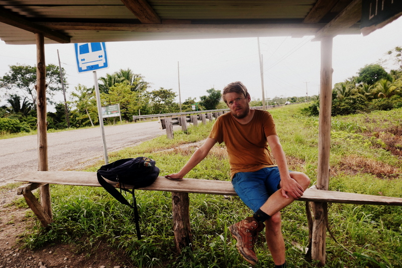 Tom in bus stop in Belize
