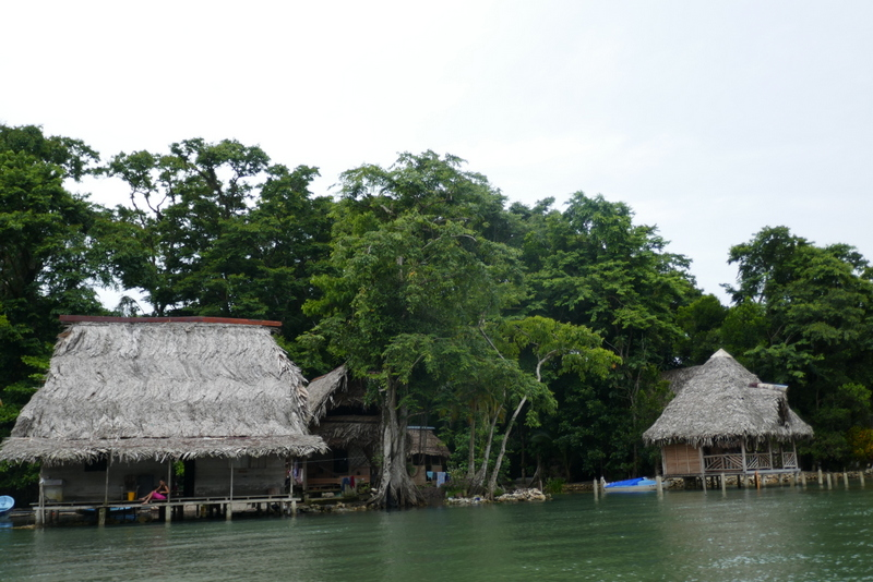 wooden houses on the shores of the Rio Dulce
