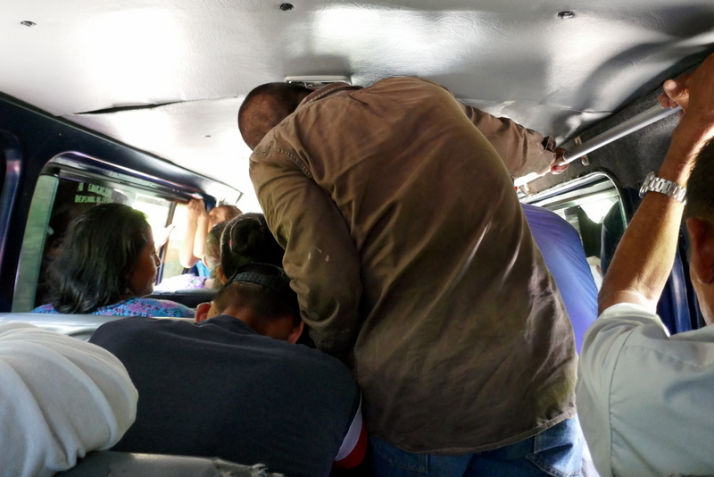 Chicken buses in Guatemala are often cramped.