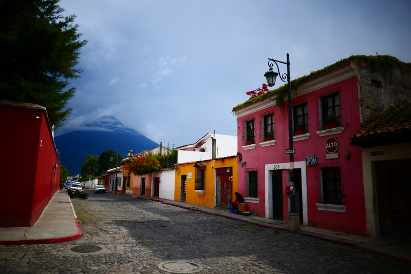 A street in Antigua Guatemala, with Volcán de Agua in the background.