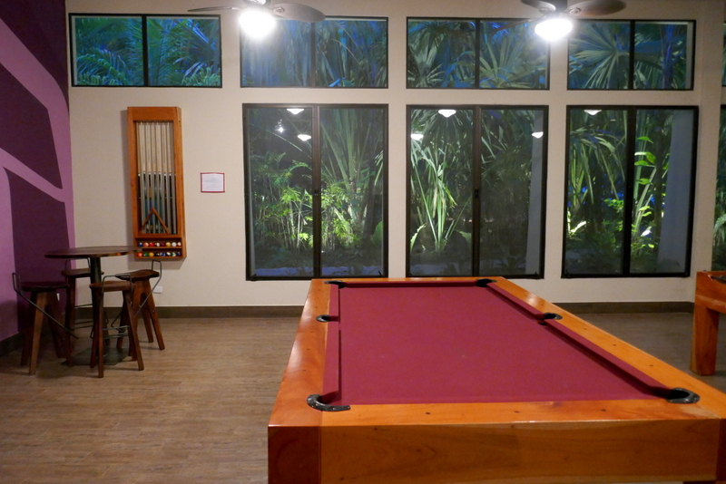 Playing pool in jungle setting at Jungle Lodge, Tikal national park.