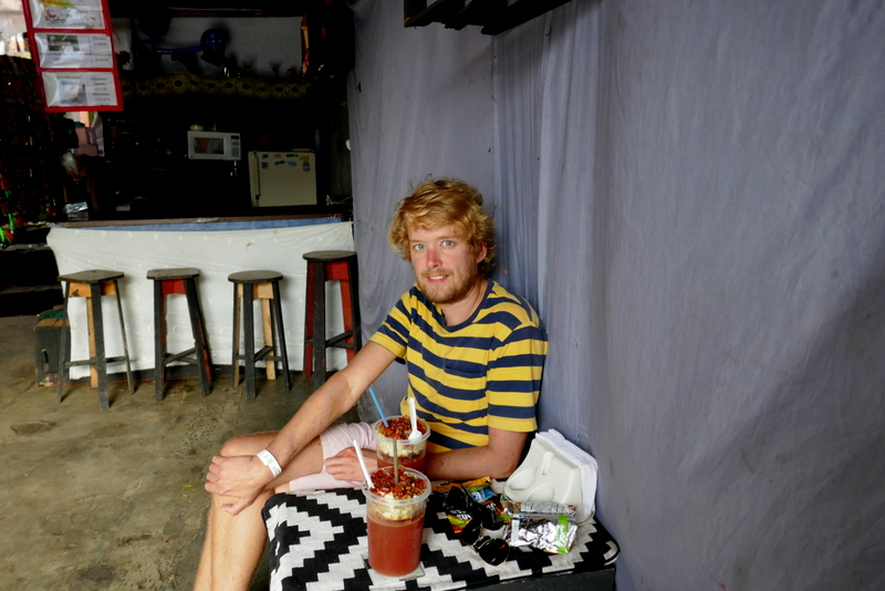 Tom enjoys a michelada in a local bar in Cobán, Guatemala.