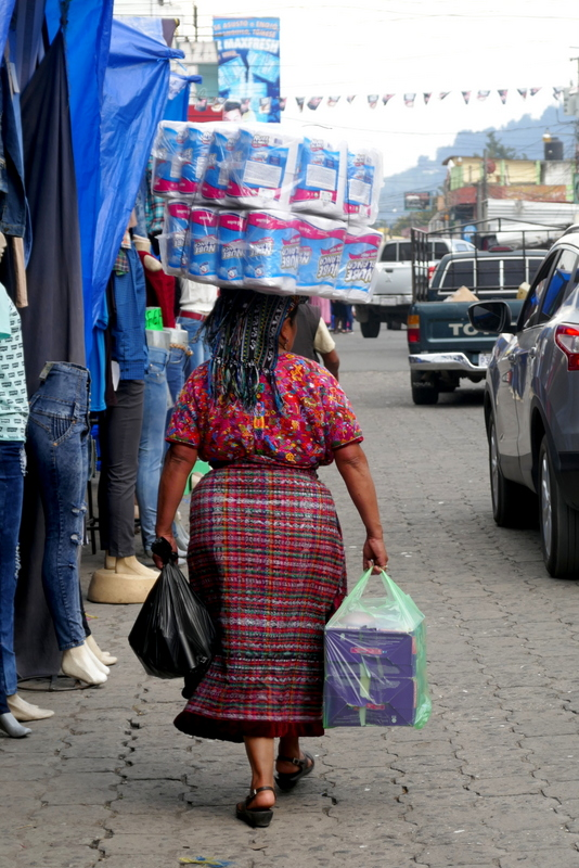 Traditional Mayan lady carrying groceries in Xela.