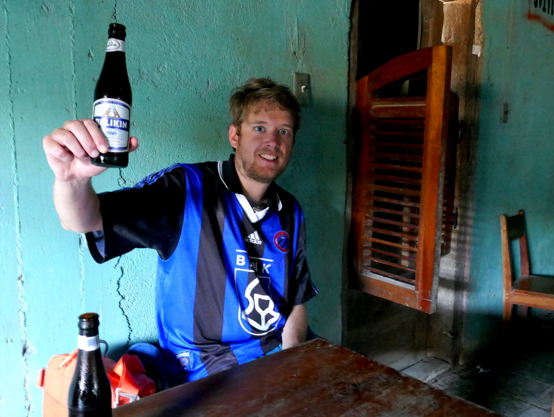 Tom celebrates FC Bruges' championship with a Belikin Stout in a bar in San Antonio, Belize.