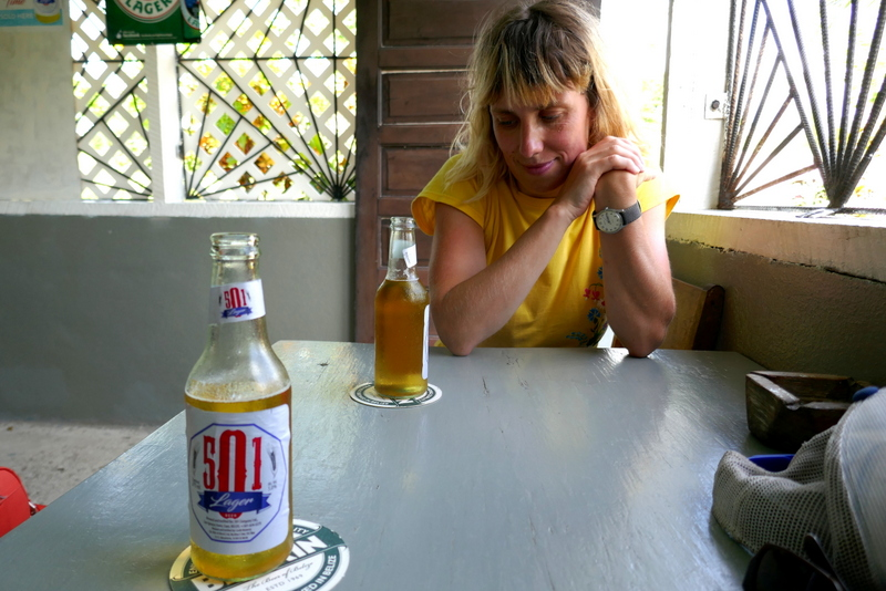 Anete drinks a 501 in San Antonio, one of the foreign beers in Belize.