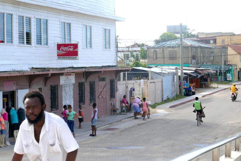 Garifuna people in Dangriga, in front of King Burger Restaurant.