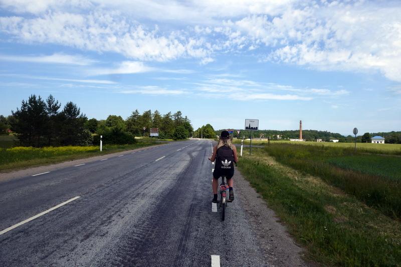 Anete cycles into Toila, Estonia.