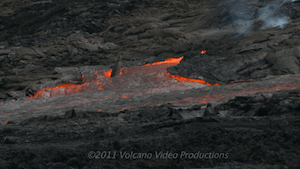 Crust tearing from sides of rushing lava channel