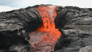 Lava pouring over falls and splashing into a pool