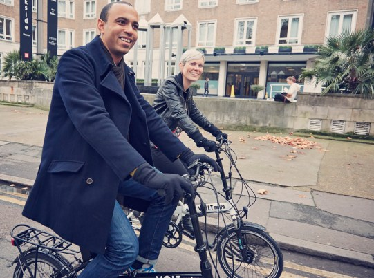 Couple on e-bikes in the city