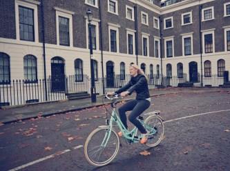 Lady on VOLT Kensington cycling through London