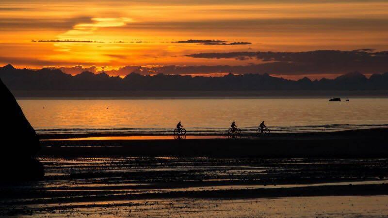 Cycling along the coast at sunset