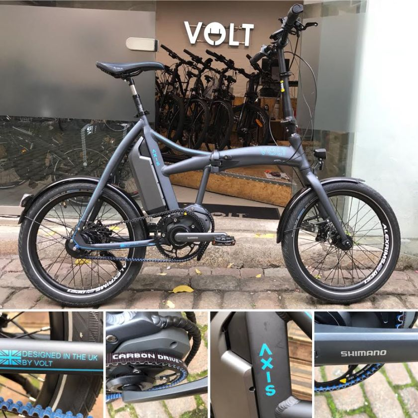 The VOLT Axis folding e-bike parked outside the VOLT showroom