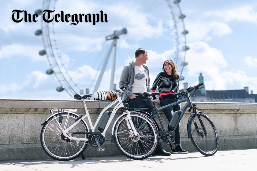 A couple stands across from the London Eye with their VOLT Pulse LS and VOLT Infinity