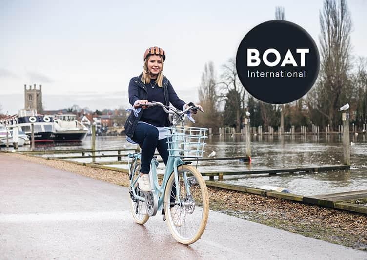 Girl riding VOLT™ Kensington near the river