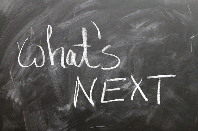 "A black chalkboard with the words ""what's NEXT"" written on it"