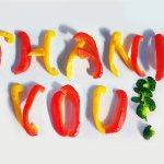 The words Thank You spelled out using vegetables