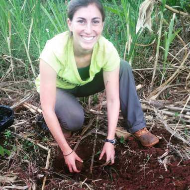 Kate planting an orange tree