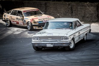 Cars exiting the paddock onto the hill at Goodwood Festival of Speed