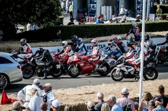 Motorbikes waiting to re-enter the Goodwood paddock