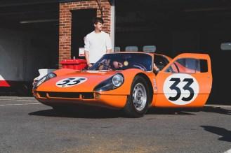 Orange 1964 Porsche 904 Carrera GTS pit garage