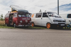 Red bay window camper and Type 4 van