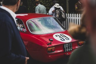 1965 Alfa Romeo 1600 GTA through the crowds, Goodwood Revival.
