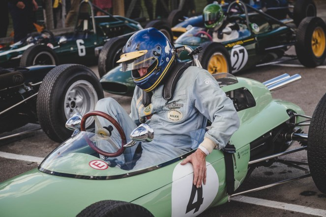 Andrew Beaumont exiting his 1962 Lotus-Climax 24, Goodwood Revival.