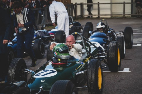 Wheel off, gloves off, helmet off, Goodwood Revival.