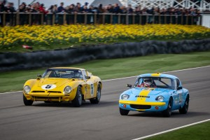 Yellow and blue 1960's sports cars racing