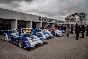 Line of Le Mans LMP1 race cars in Goodwood paddock