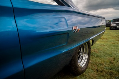 Side badge and quarter panel of blue Doge Charger RT muscle car