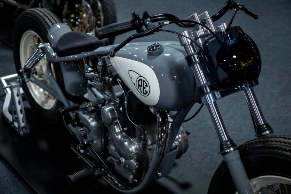 Grey and white Royal Enfield motorcycle