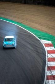 Blue Mini car skidding into corner