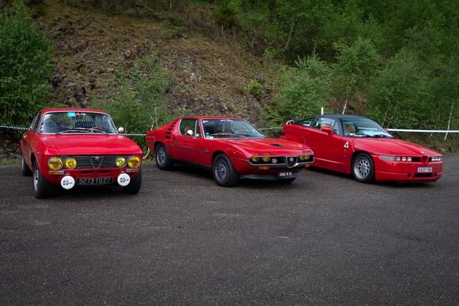 Three red Alfa Romeos