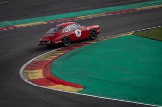 Hard cornering red Porsche 911