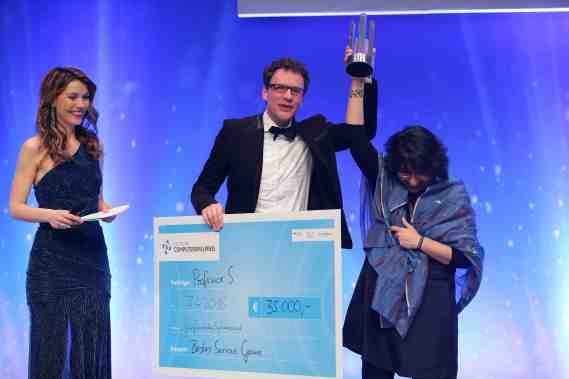 MUNICH, GERMANY - APRIL 07: Team members of 'Professor S.' receive their award from Nova Meierhenrich during the German Computer Games Award 2016 (Deutscher Computerspielpreis 2016) at BMW World on April 7, 2016 in Munich, Germany. (Photo by Gisela Schober/Getty Images for Quinke Networks)