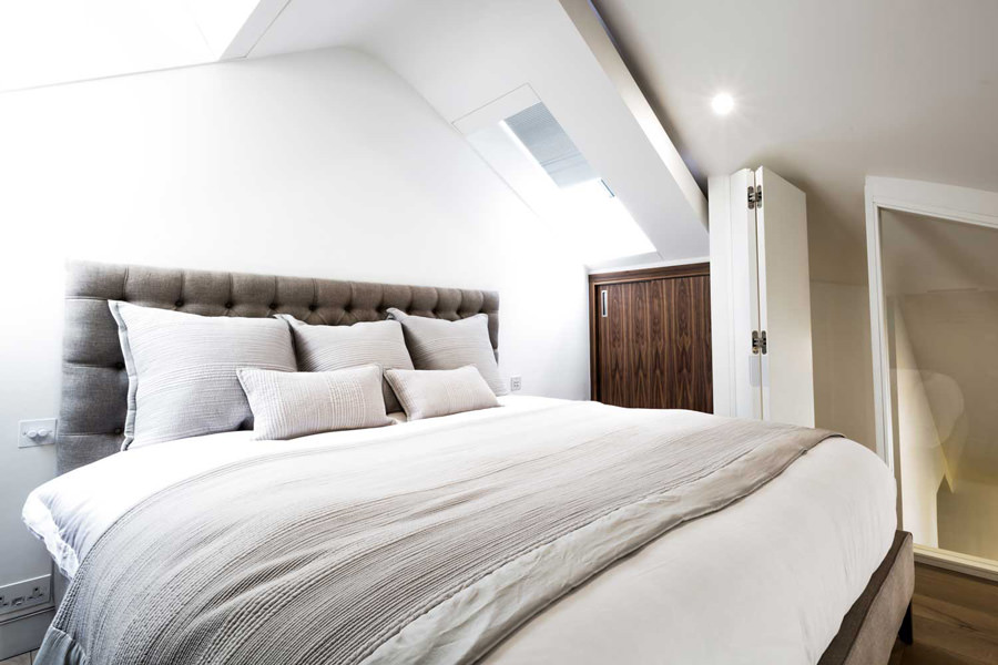 0244 mezzanine master bedroom with fitted wardrobes and roof lights in modern penthouse London