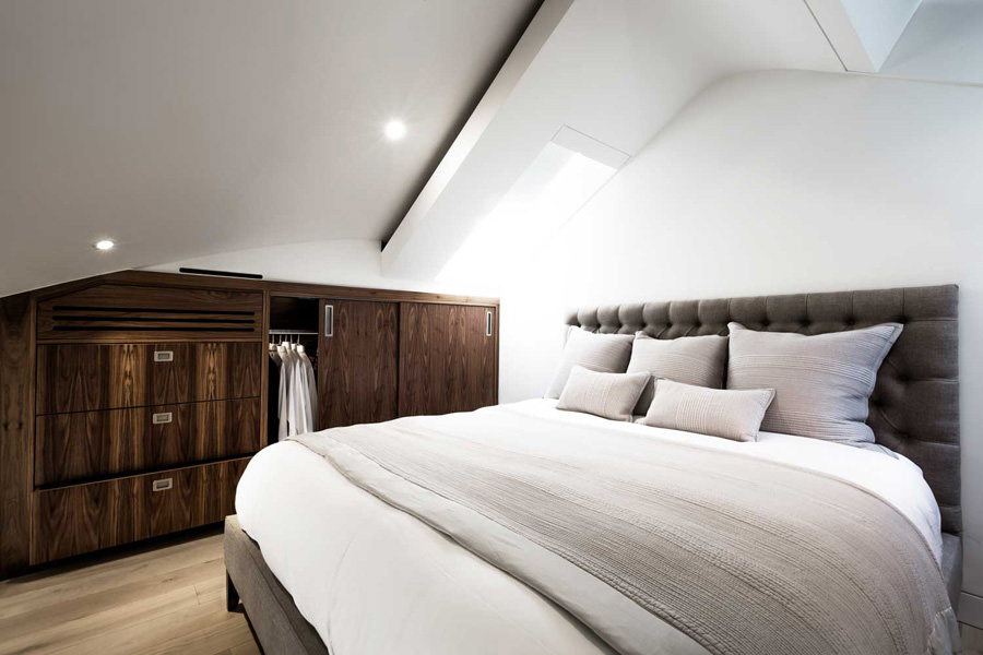 0244 mezzanine master bedroom with fitted wardrobes and roof lights in St Johns Wood