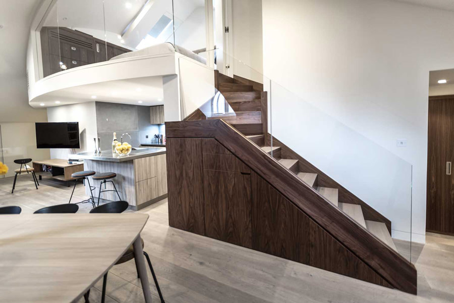 0244 mezzanine staircase with dark wood and frameless glass balustrade on Abbey Road NW8