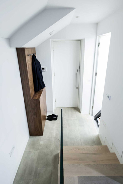 0244 Entrance hallway coat and shoes storage and wooden stairs with a glass balustrade