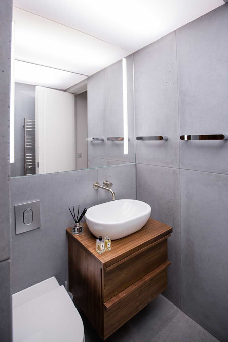 0244Church conversion penthouse concrete tiles bathroom and bowl basin with wooden vanity unit in north west london