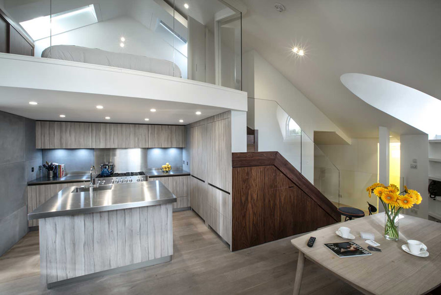 0244 modern dining room and kitchen with mezzanine bedroom above in St Johns Wood London