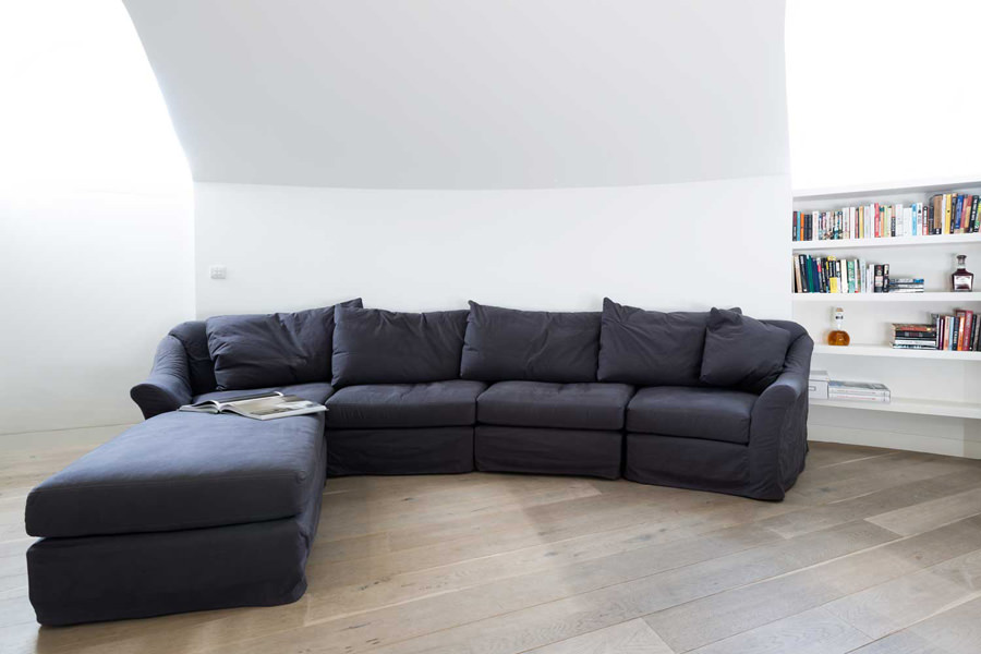 0244 curved L shape grey sofa in living room in penthouse in North West London